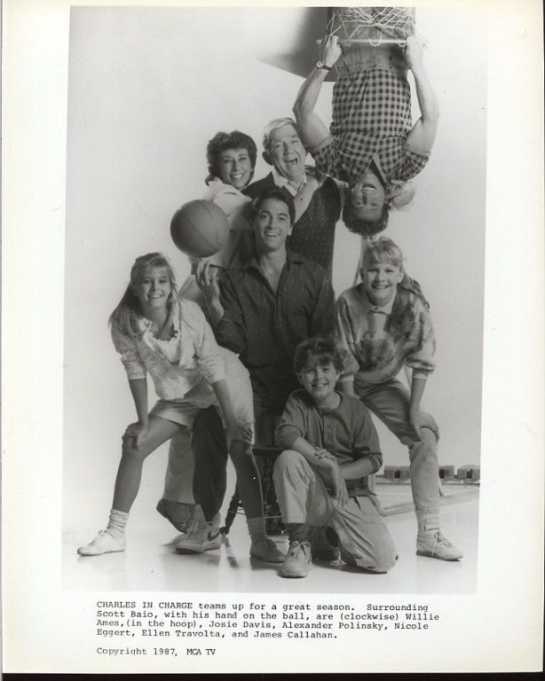 CHARLES IN CHARGE teams up for a great season. Surrounding Scott Baio, with his hand on the ball, are (clockwise) Willie Aames (in the hoop), Josie Davis, Alexander Polinsky, Nicole Eggert, Ellen Travolta, and James Callahan.