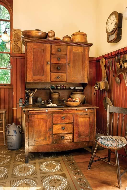 An early Hoosier cabinet, found at Aurora Mills, displays open and lidded containers..
