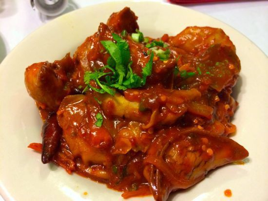 The goat momo at Everest Restaurant — dumplings filled with goat and tossed in a chili sauce — are just one of the many delectable international dishes you can find on Belt Line Road in Irving.