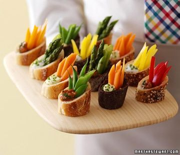 Cut a baguette on an angle, scoop out a little, fill with dip, add a few strips of veggies - YUM! Great appetizer idea!