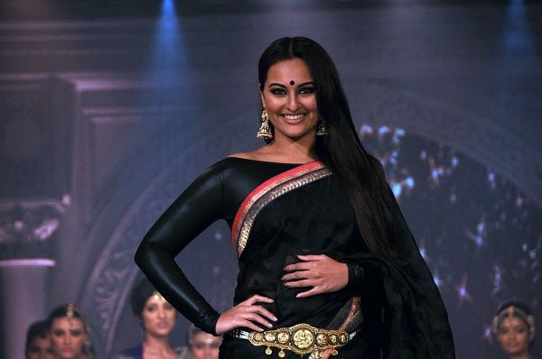 Bollywood actress, Sonakshi Sinha walks for fashion designer Rajguru's creation... She wore a Black saree with black boat-neck blouse...