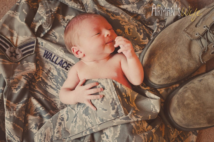 Newborn Photography... I can't wait to do this with Aaron's uniform!!