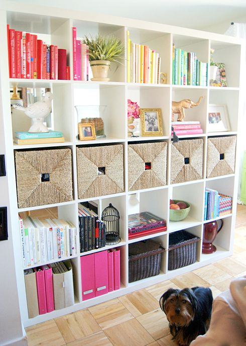 Organized + styled... white book shelves with books organized by color!