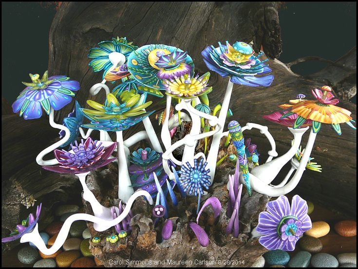 Flower Forest: A Collaboration by Carol Simmons and Maureen Carlson. Polymer clay  and wire.