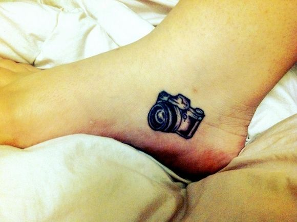 I would love to get a camera as a tattoo because my sister loves cameras and so do I and I love her so I think it would be a good tattoo to get.