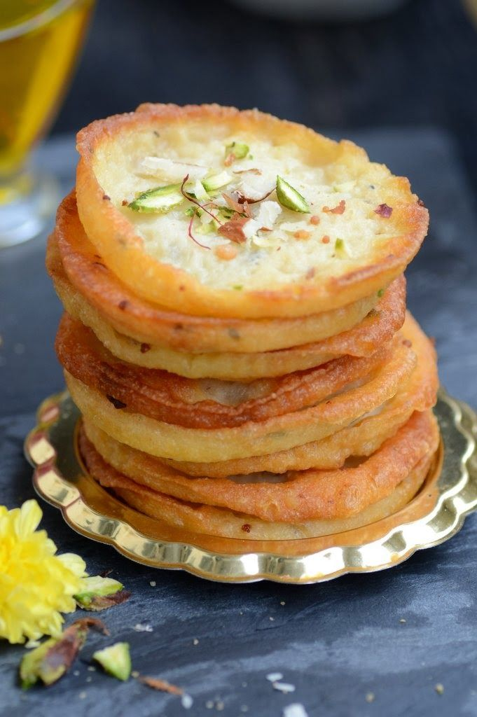Mawa Malpua is a traditional Indian sweet. It is basically a fried pancake dunked in sugar syrup.