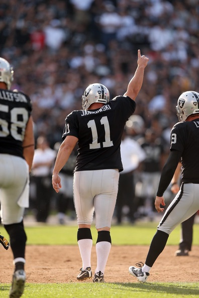 Sebastian Janikowski #11 of the Oakland Raiders celebrates after he kicked the game-winning field goal against the Pittsburgh Steelers at Oakland-Alameda County Coliseum on September 23, 2012 in Oakland, California.