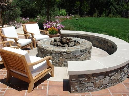 This stone fire pit offers plenty of seating for outdoor for Backyard rock fire pit ideas