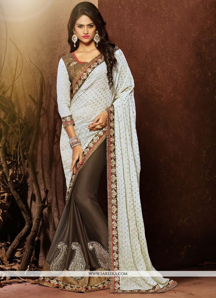 Its a master piece in its class glorifying your timeless beauty. Be ready to slip in the comfort zone of off white viscose and faux chiffon designer saree. The lovely embroidered and patch border work...