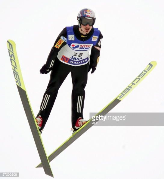 Adam Malysz of Poland soars in the air in the FIS Ski Jumping World Cup at the Lahti Ski Games 05 March 2006 Janne Happonen of Finland won the...