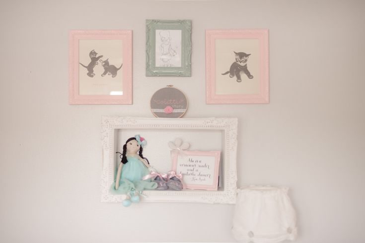We love an eclectic gallery wall and this display shelf is such a great way to showcase fun items on the wall! #rhbabyandchild #fallinlove