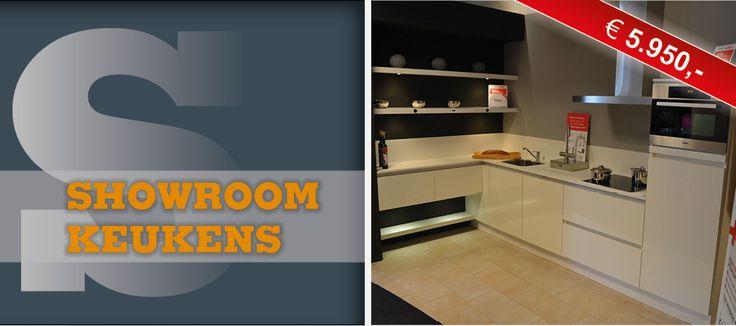 Keller - Amsterdam, wit glans, hoek 1,80 x 2,35 van € 9.750,- voor € 5.950,- greeploos. Miele vaat, kraan, koel 102, afzuig, oven, keramische, blad 2 cm met achterrand