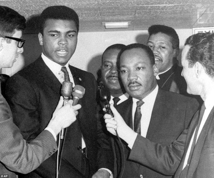 Ali (left) speaks to reporters alongside Dr Martin Luther King (right) in March 1967