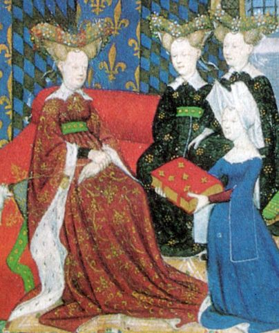 """Christine de Pisan presents her book to Queen Isabeau of France. She and her ladies wear jewelled heart-shaped stuffed or hollow """"bourrelets"""" on top of hair dressed in horns. Christine wears a divided hennin covered in white cloth."""