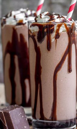 Frozen Mudslide Drink - Enjoy this creamy, decadent frozen treat with or without alcohol for the ultimate summer drink. Great for parties or to just treat yourself! This chocolate recipe is super quick and easy and a fun beverage to serve at a July 4th or Labor Day picnic. Whipped cream vodka, Kahlua, and Bailey's Irish Cream in the alcoholic version can be replaced with coffee and creamer in the non-alcoholic recipe, but don't worry. Both delicious recipes have ice cream!