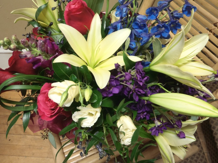 Lovely Vase of Yelloween Lilies, Delphinium, Cherry Oh Roses, Stock, Snapdragon's and Lily Grass loops