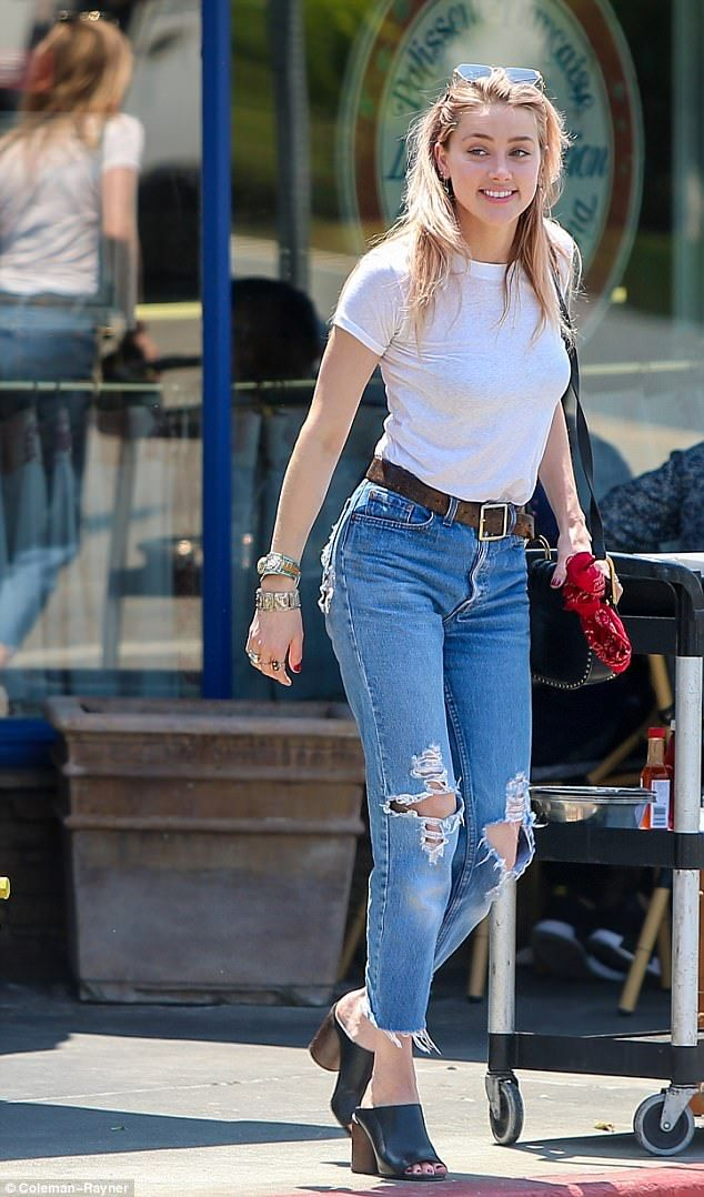 All smiles: Amber Heard was seen taking a cheery stroll through Beverly Hills Friday. That...