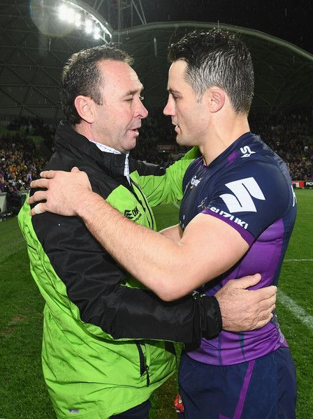 Ricky Stuart the coach of the Raiders hugs Cooper Cronk of the Storm during the NRL Preliminary Final match between the Melbourne Storm and the Canberra Raiders at AAMI Park on September 24, 2016 in Melbourne, Australia.