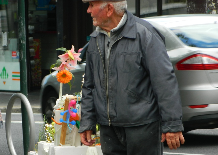 Every Saturday you can buy a flower or a tennis ball from this man.