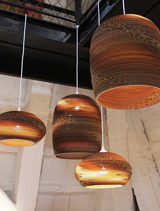 Made out of re-purposed cardboard, the organic composition and modern shape of Scrap Lights by Graypants cast a warm glow with shadows and light that dance along walls.