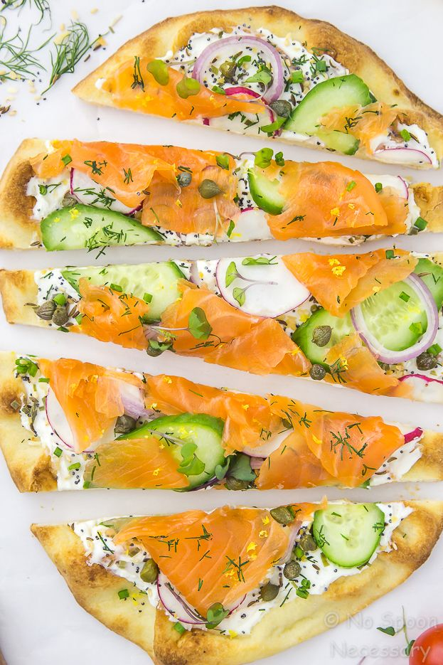 Loaded Spring Salmon Pizza - Pillowy soft naan bread slathered with everything bagel spiced cream cheese, and generously topped with crisp spring vegetables, fresh herbs and cured (or smoked) salmon.  This Spring Salmon Pizza is fast, flavorful, and absolutely fabulous!