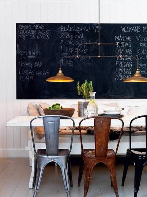 I think I need a huge chalk board in my kitchen; I seem to love them. Again, blackboard with rustic wood, a little green accent, some white painted furniture, industrial lighting and chair. I'm available to move in here as soon as the owner contacts me!
