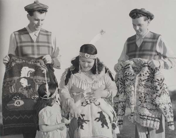 1950 - Margaret Rose Charlie and her daughter are holding Cowichan Sweater - www.cowichanvalleymuseum.bc.ca archival