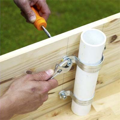 attaching the pipe strap assembly to the teeter-totter board