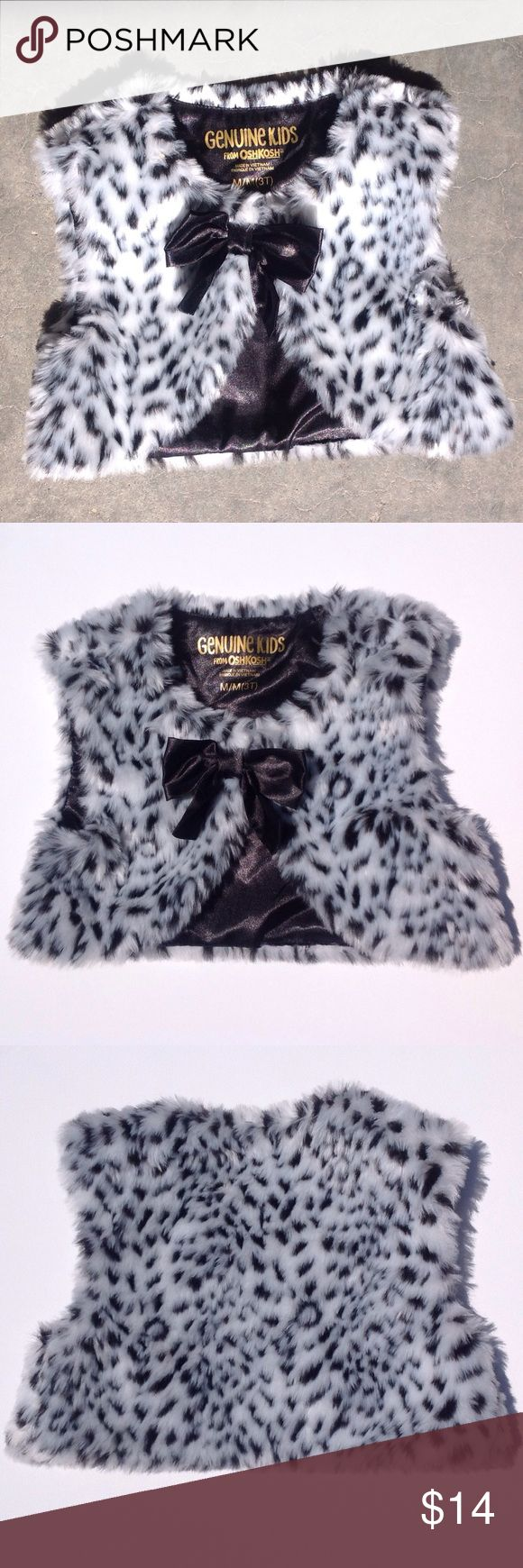 OshKosh Vest - 3T 🐼HP@cmsblaz🐼@miss_marcar Black and white girls animal print vest with satin bow and snap collar. Polyester/acrylic. Size label M/M 3T Color most accurate in photo 2 Osh Kosh Jackets & Coats Vests