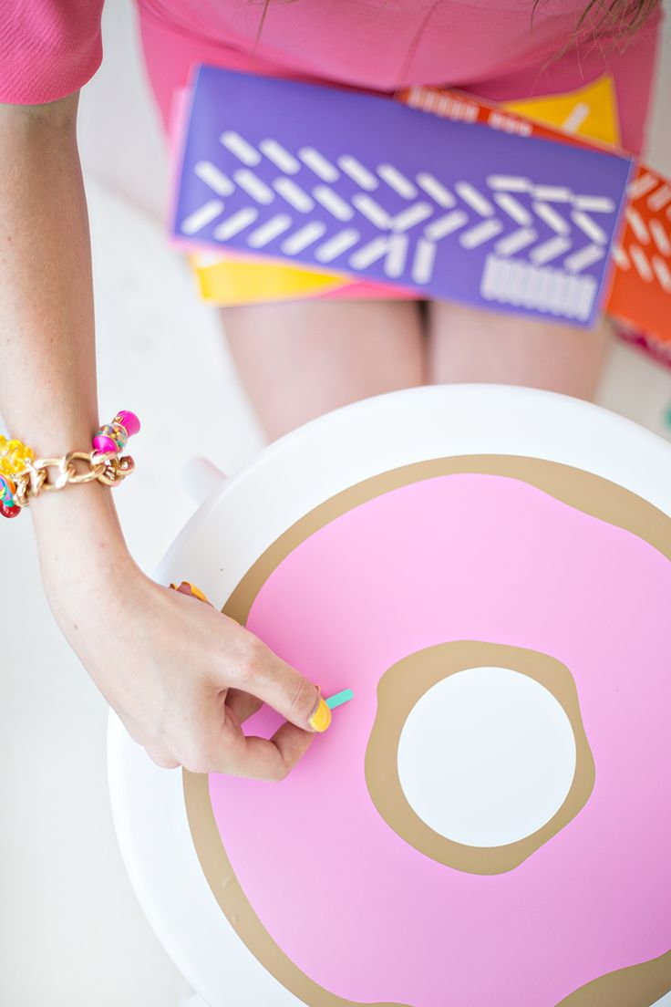 DIY Donut Stools - OP uses a Cricut to make shapes out of vinyl, but obviously you could do this with paint!