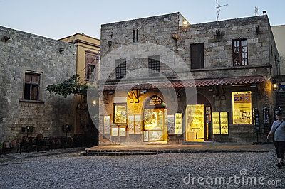 Street with shops in Rodhes city by night , Rhodes Island, Greece . Europe.