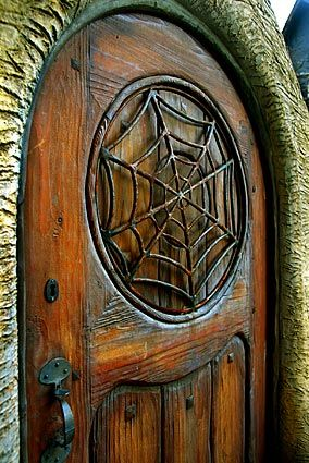 incredible carved wood door to the witch's house in beverly hills, california
