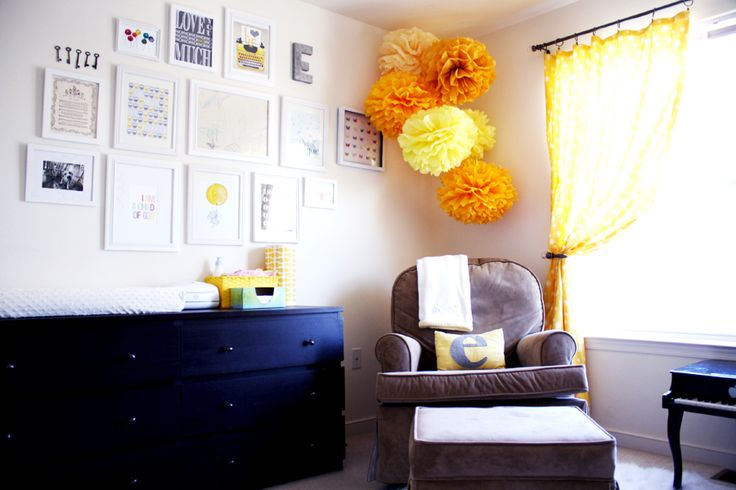 Nursery from House of Wood - love the picture wall, bright pompoms and comfy furniture