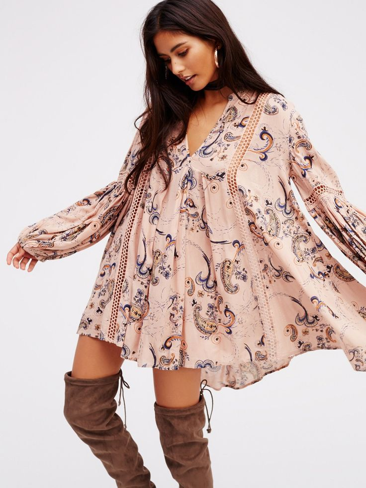 Just the Two of Us Paisley Printed Tunic | Crinkly babydoll paisley printed swing tunic featuring crochet insets and pleat detailing. V-neckline and elastic cuffs with wide statement sleeves.