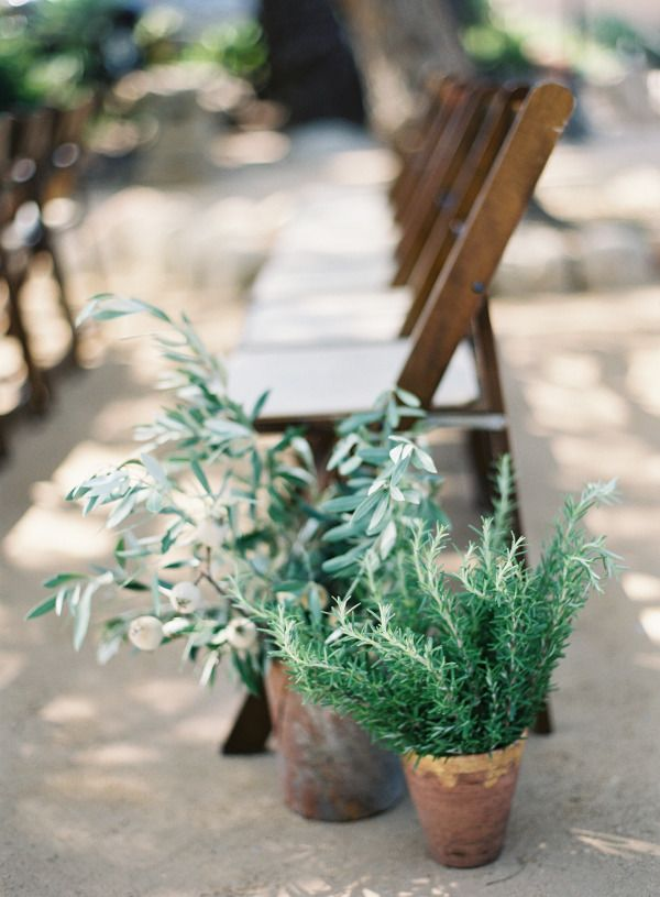 Simple planters: http://www.stylemepretty.com/2015/06/27/wedding-decor-to-up-your-aisle-style/