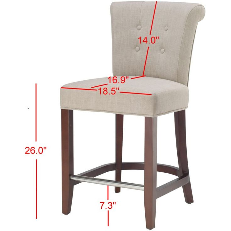 """Give your bar a sophisticated look with the Safavieh 25.7"""" Bar Stool with Cushion. This square bar stool sports an elegant brown finish that adds elegance and class to a room. Engineered from solid wood, the 25.7"""" Bar Stool with Cushion Safavieh by is amazingly sturdy and long lasting. Upholstered with a beige fabric, the seat of this bar stool features tufted buttons. You can sit comfortably without straining your back thanks to the back rest on this bar stool. You can rest your fe..."""