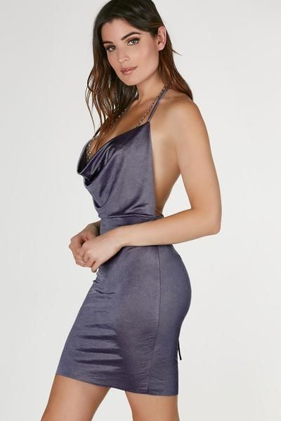 """Sexy halter neck mini dress with smooth satin-like finish. Draped design, open back with ties for closure.  100% Polyester Made in USA Model is wearing size S Runs true to size Hand wash cold Approx. length: 33"""" (measured from size S)"""