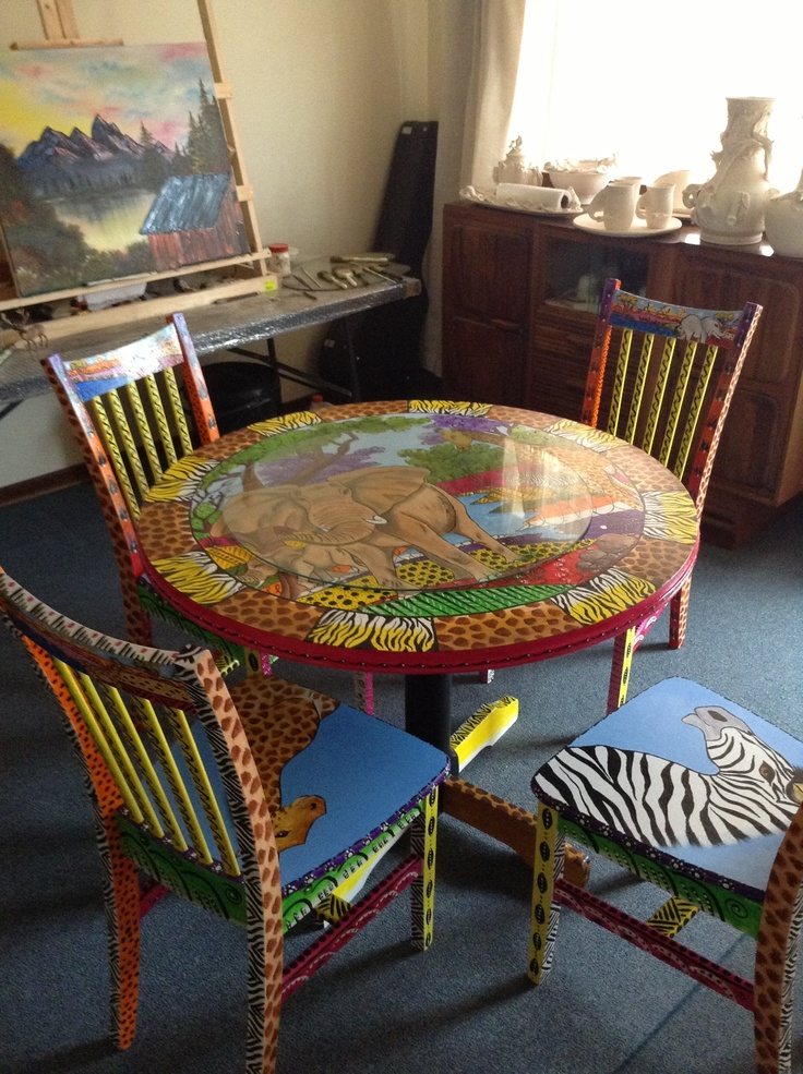 "Wood table painted ""Sebu"" style ... named in honor of an African orphan who recently passed away."