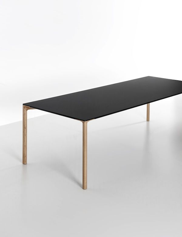 Kristalia Boiacca dining room table - beautiful, minimalist design with a black top and oak legs