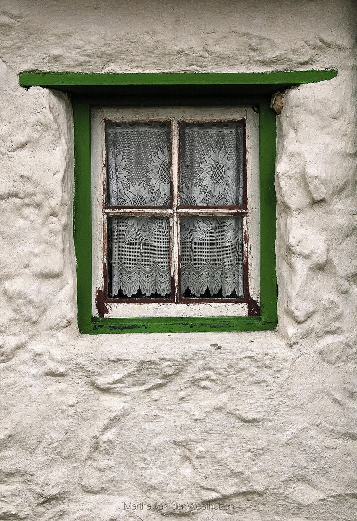 The green window of an historic fisherman's cottage,Western Cape, South Africa