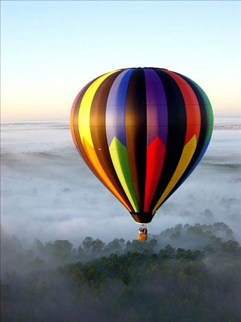 Fly in a big air balloon...