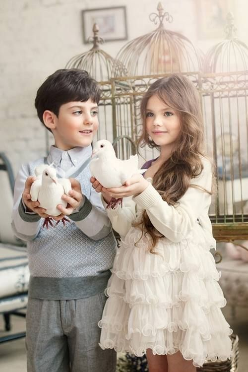 Just beautiful, doves and children--the definition of love and peace...I will treasure this photo in my mind the rest of my life...you can't take your eyes off these beautiful children and then there's the doves!!Flower Girls Dresses, Little Girls, Kids Fashion, Children, Kidsfashion, Birds, Little Boys, Celebrities Kids, Girls Hair