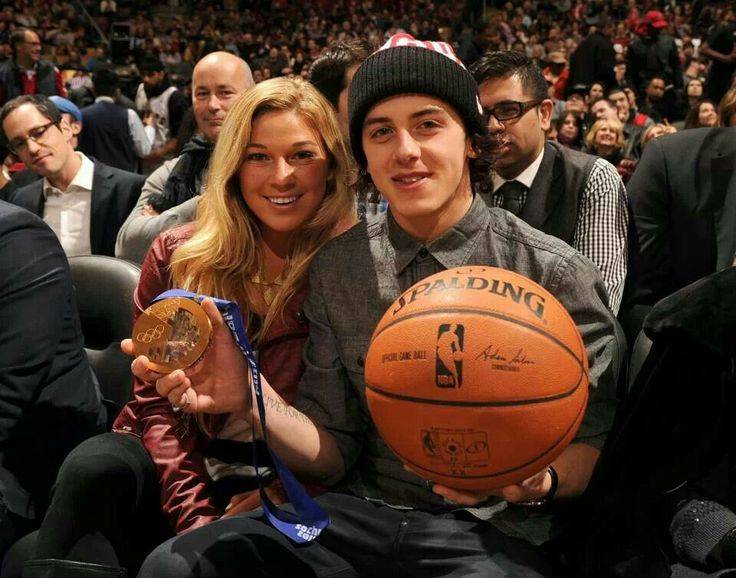 Mark McMorris at basket ball game with Olympic gold iedal