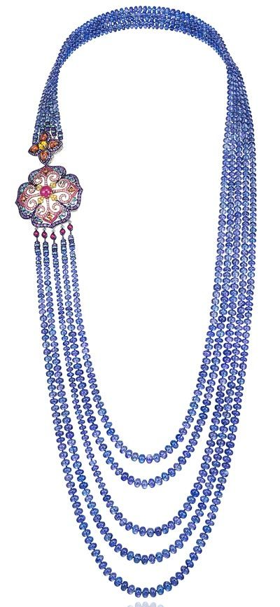 -  <b>Necklace</b> in18ct white gold and titanium set withtanzanite beads (843cts) – mutlicolored sapphires (8.5cts) – amethysts (7.6cts) – rubies (5cts) – Paraiba tourmalines (3.9cts) and tanzanites (1.6ct) – <b>Ref.: 819738–9001</b>