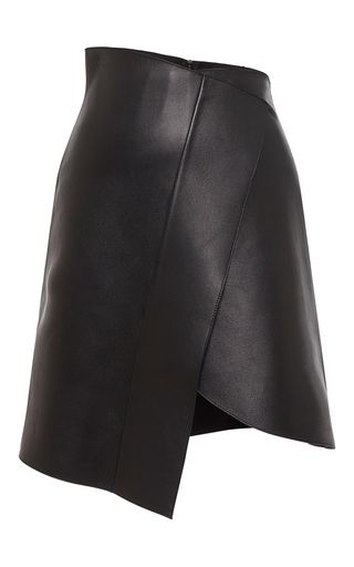This **David Koma** leather skirt features a mid rise and a wrap style with an asymmetric mini length hem.