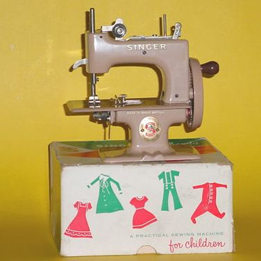 1950s Toy sewing machine..I still have one!  i have this too...& the box....but mine is ripped.... it really sewed.... i could make doll clothes with it..