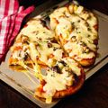 "Another recipie from Chef Nigella Lawson - ""Naan Pizza"" - easy and delicious!"