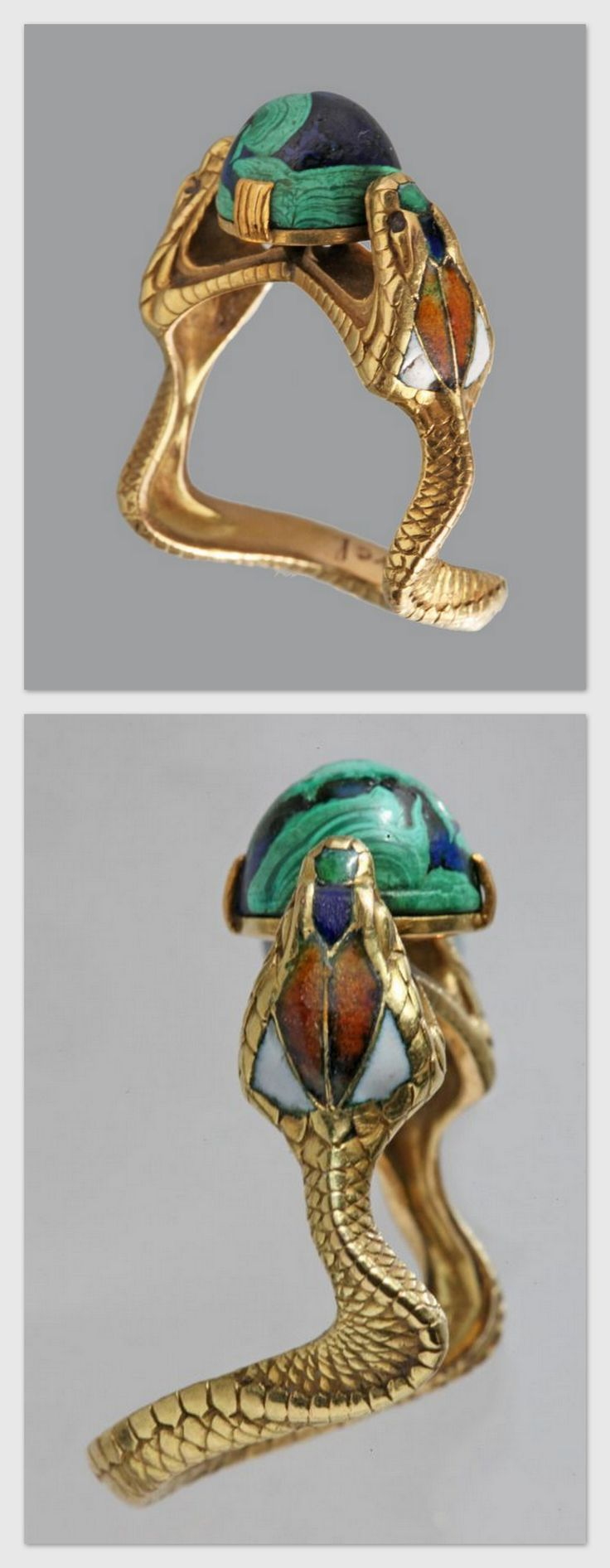 CHARLES BOUTET DE MONVEL 1855-1913. The Hooded Cobras clutching a blue green cabochon 'world', gold, enamel, lapis and malachite. Marks: Signed 'B. de Monvel', French, c.1900.