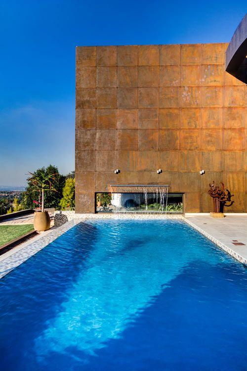 Sculptural Steel Walls and Infinity Pool: