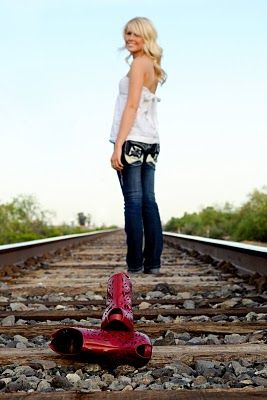 Here's another neat railroad picture, only  with a shirt that doesn't blend in with the background, and maybe boots, cowboy hat, or something else other than high heels.